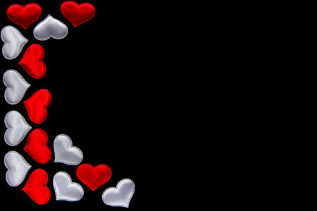 Lots of white and red hearts on black background