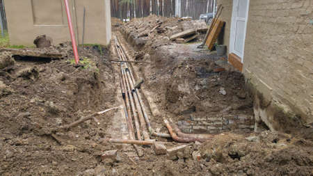 Breakthrough city hot water system. Repair and replacement of steel pipes. Earthwork