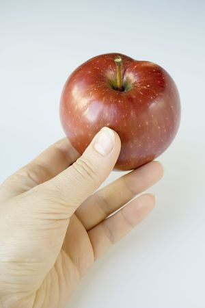 red appetite apple at human hand Stock Photo - 7780322