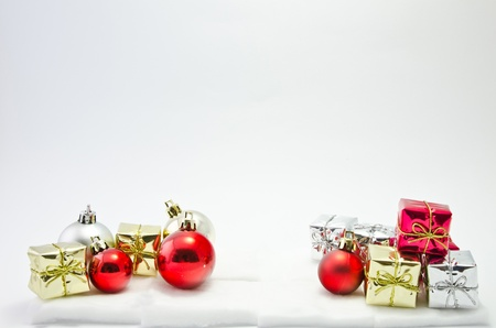 gift boxes with balls isolated on white background Stock Photo