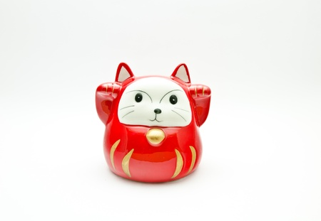maneki: red lucky cat   Maneki Neki  on white background