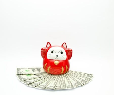 red lucky cat on money with white background