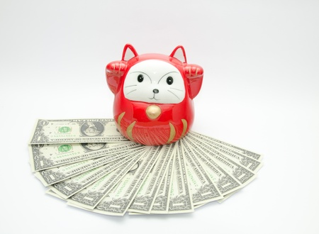maneki: red lucky cat on money with white background