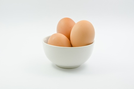 Three eggs in bowl on white background  Stock Photo - 13630397