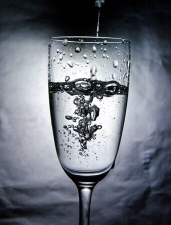 The water bubble in the glass on white background