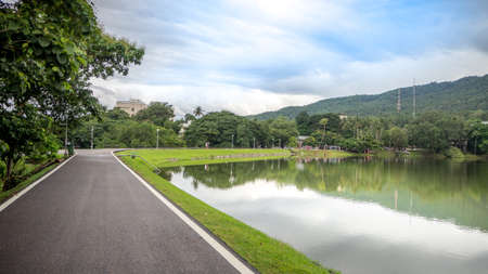 The road along the reservoir in Chiang Mai University,Thailand. Stock Photo