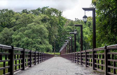 Bridge over the reservoir in Chiang Mai University,Thailand. Banco de Imagens