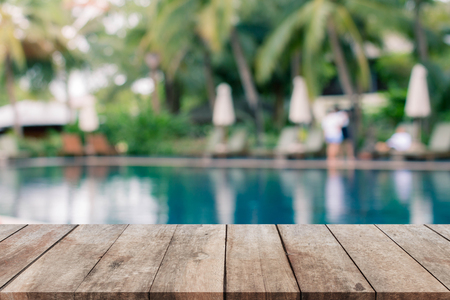 Stock Photo   Wood Table Top And Blurred Swimming Pool Background.   Can  Used For Display Or Montage Your Products.