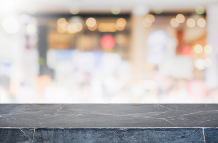 Stone table top and blurred restaurant interior background - can used for display or montage your products.