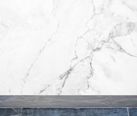 Black stone table top and background of white marble stone wall - can used for display or montage your products. Stock fotó