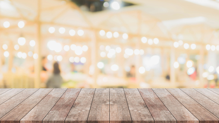 Wood table top and blurred restaurant interior background - can used for display or montage your products.
