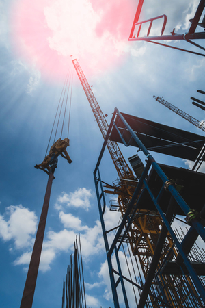 Abstract real estate construction site buildings with sky and sun ray background.Vintage tone Stock Photo