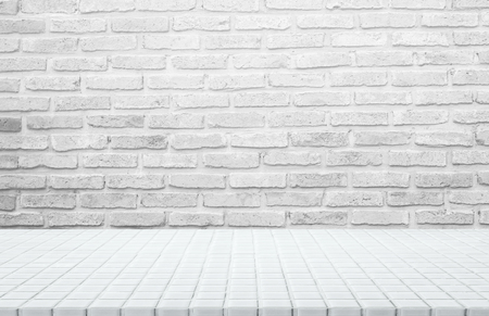 White ceramic mosaic table top and background of grey brick wall - can used for display or montage your products.