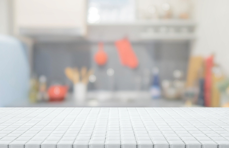 White ceramic mosaic tile table top and blurred kitchen interior background - can used for display or montage your products. Stock Photo