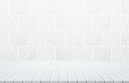 White ceramic mosaic table top and background of grey granite stone tile wall - can used for display or montage your products.