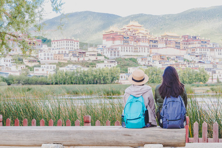 Female tourists are traveling in Little Potala Palace Lamasery The famous temple in shangri-la , yunnan , china