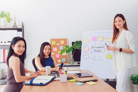 Group of beautiful Asian women meeting in office to discussion or brainstorm business startup project.Concept of teamwork of empower woman. Imagens