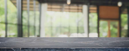 Empty black marble stone table top and blurred coffee shop, cafe and restaurant interior background - can used for display or montage your products.