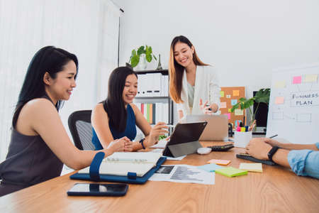 Group of beautiful Asian women meeting in office to discussion or brainstorm business startup project.Concept of teamwork of empower woman.