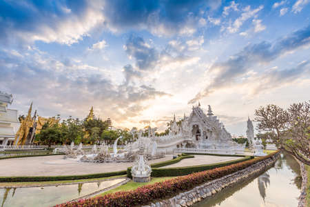 thailand: Wat Rong Khun (Rong Khun Temple) in golden hour Stock Photo