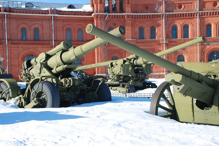 Russia. Saint-Petersburg. Russian Second World War guns covered with snow at the courtyard of the Artillery Museum. Editorial