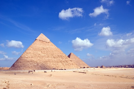 Egypt. Giza. View of the Hefren and Cheops pyramids with Cairo at a distance.
