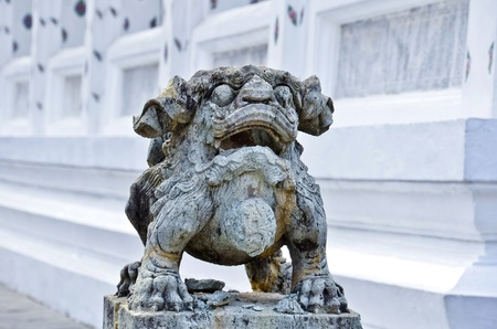 Stone sculpture  in the wat arun temple of thailand photo