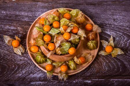 cape gooseberry: Cape Gooseberry on a wooden bowl