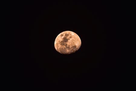 gibbous: The orange Waxing Gibbous moon