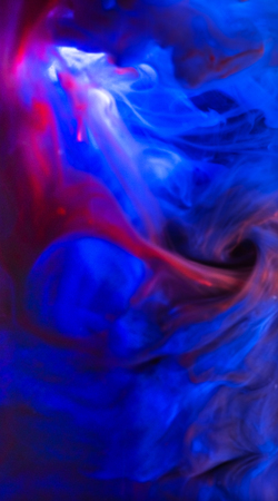 Colorful ink swirling in water Stock Photo