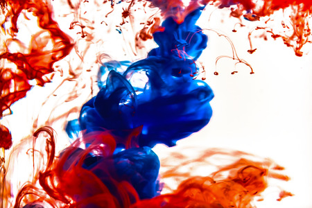 mauve: Colorful ink swirling in water Stock Photo
