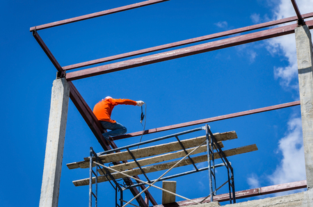 reckless: Construction workers working on high risk