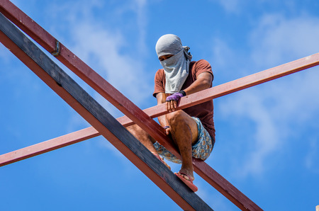 Construction workers working on high risk
