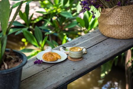 Breakfast with coffee and croissants on the garden terrace