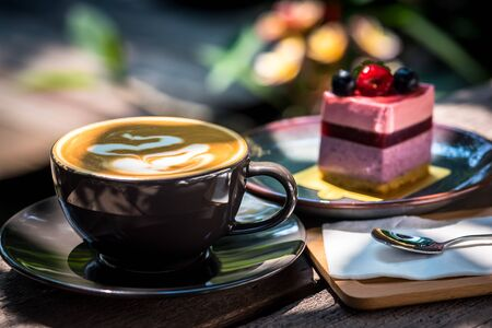 Breakfast with coffee and blueberry cheesecake on the garden terrace 版權商用圖片