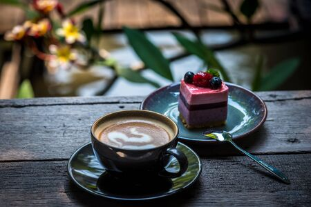 Breakfast with coffee and blueberry cheesecake on the garden terrace Фото со стока