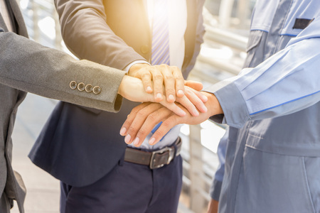 Success Teamwork concept, Business people joining hands city background.