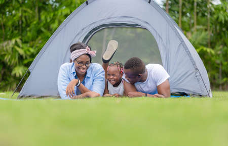 Cheerful african american family enjoying in the park, Happiness family concepts