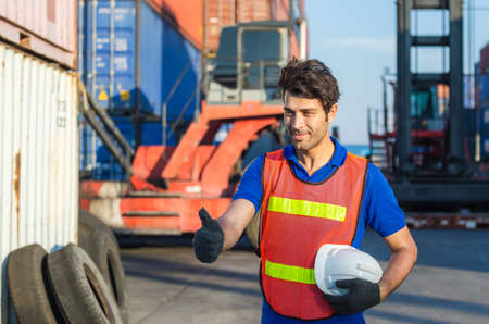 Cheerful factory worker man smiling with giving thumbs up as sign of Success Standard-Bild
