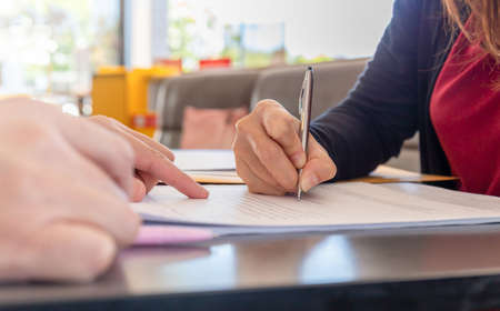 Close up of woman's hand with pen signing document, Deal concept Imagens