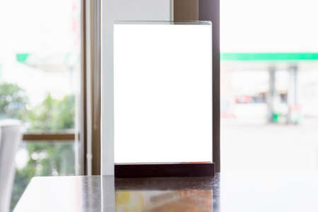 Blank flyer mockup glass plastic transparent holder poster display in coffee shop Reklamní fotografie
