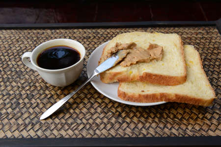 out time: Peanut butter on homemade bread with coffee. Chill out time in countryside of Thailand