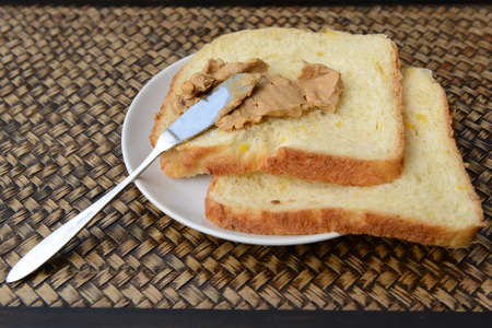 out time: Peanut butter on homemade bread. Chill out time in countryside of Thailand Stock Photo