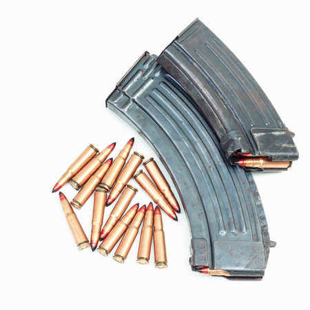 rifle bullet and ammunition pouch on white background