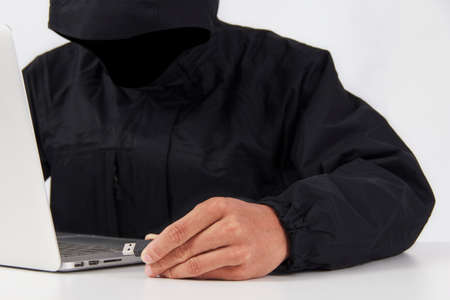 Laptop is hacked by users online targeted threats important data on white background Stock Photo