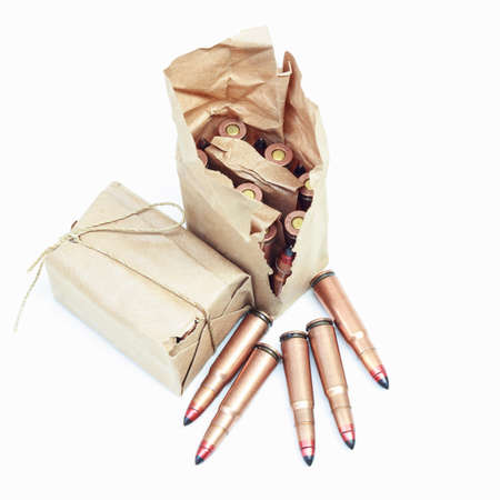 Rifle bullet   on white background:Choose a focal point ammunition lying.