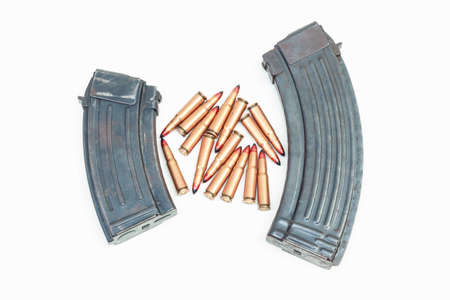 rifle bullet and ammunition pouch on white background:Choose a focal point ammunition lying. Stock Photo