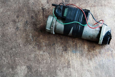 Steel pipe explosive (IED) is ignited by cell phone for background Stock Photo