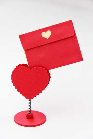 paper pin: Empty envelope  paper attached to message holder red heart peg on white background for Valentine day