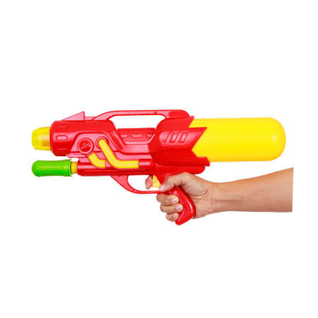 Womans hand holding water gun isolated on white background and clipping path.